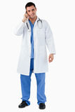 Portrait of a doctor making a phone call Royalty Free Stock Images