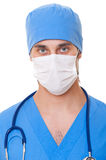 Portrait of doctor in mask and blue uniform. Isolated on white background Royalty Free Stock Photo