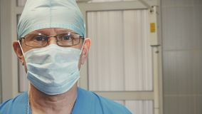 Portrait of a doctor with a medical dressing goggles glasses and nods his head. Close up Royalty Free Stock Images