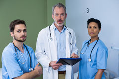 Portrait doctor and nurse discussing over clipboard in ward Royalty Free Stock Photo