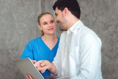 Portrait of doctor and nurse are discussing something in office royalty free stock photos