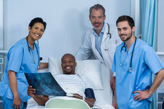 Portrait of doctor, nurse and patient in ward. During visit Royalty Free Stock Images