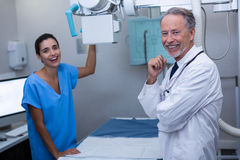 Portrait of doctor and nurse in x-ray room. At hospital Stock Photo