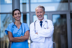 Portrait of doctor and nurse standing with arms crossed. In hospital Royalty Free Stock Photo