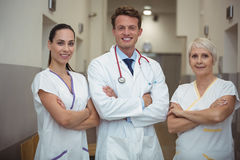 Portrait of doctor and nurse standing in corridor Stock Images
