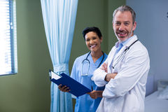 Portrait of doctor and nurse standing in ward. Of hospital Stock Image