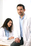 Portrait of a doctor and a nurse working. View of a doctor and a nurse working Royalty Free Stock Photos