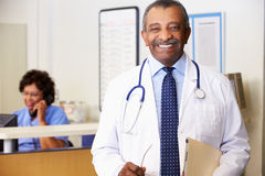Portrait Of Doctor At Nurses Station Stock Photography