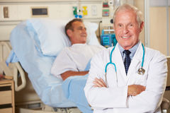 Portrait Of Doctor With Patient In Background Stock Images