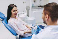 Doctor and patient looking at jaws model royalty free stock photo