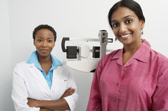 Portrait of Doctor And Patient With Scales In Background Stock Photo