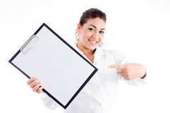 Portrait of doctor pointing notepad Royalty Free Stock Photos