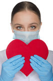 Portrait of a doctor with red heart symbol Royalty Free Stock Photos
