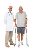 Portrait of a doctor with senior man using walker Royalty Free Stock Photo
