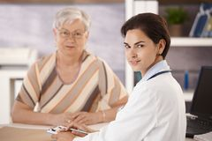 Portrait of doctor and senior patient royalty free stock photos