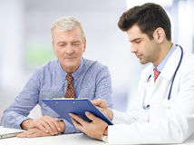 Portrait of doctor with senior patient Stock Image