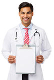 Portrait Of Doctor Showing Blank Paper On Clipboard Stock Images