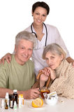 Portrait of doctor and sick older caucasian couple Stock Photos