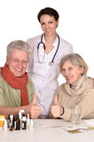 Portrait of doctor and sick older caucasian couple Stock Image