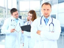 Portrait doctor smiling with colleagues Royalty Free Stock Photography