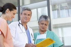 Portrait of doctor and staff Royalty Free Stock Photos