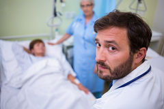 Portrait of doctor standing in hospital room Royalty Free Stock Photo