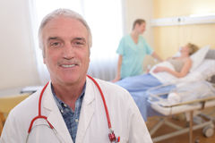 Portrait doctor standing in hospital room Royalty Free Stock Photography