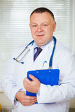 Portrait of Doctor with stethoscope looking at the camera. Royalty Free Stock Image
