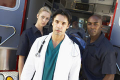 Portrait of doctor with two paramedics Royalty Free Stock Photography