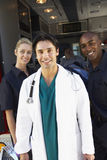 Portrait of doctor with two paramedics Royalty Free Stock Images