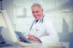 Portrait of doctor using digital tablet Stock Photo