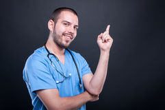 Portrait of doctor wearing scrubs with stethoscope having idea Royalty Free Stock Images
