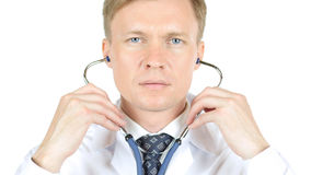 Portrait of Doctor wearing stethoscope, White Background. High quality Royalty Free Stock Photos