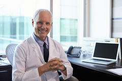 Portrait Of Doctor Wearing White Coat In Office Royalty Free Stock Image