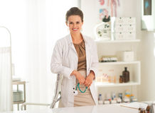 Portrait of doctor woman holding stethoscope Royalty Free Stock Photo