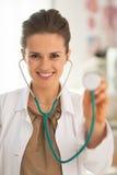 Portrait of doctor woman using stethoscope Stock Photo