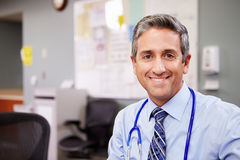 Portrait Of Doctor Working At Nurses Station Stock Photography
