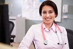 Portrait Of Doctor Working At Nurses Station Royalty Free Stock Photography