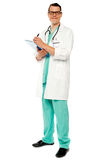 Portrait of doctor writing prescription Royalty Free Stock Images