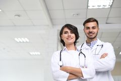 Portrait of doctors in coats. At workplace stock photography