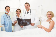 Portrait of doctors and patient with x-ray Stock Photography