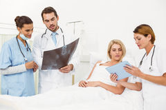 Portrait of doctors and patient with x-ray Royalty Free Stock Photography