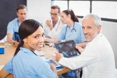 Portrait of doctors smiling in conference room Stock Images