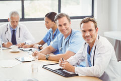 Portrait of doctors smiling in conference room Stock Photo