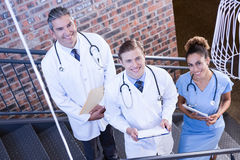 Portrait of doctors standing on staircase with document Royalty Free Stock Photo