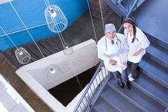 Portrait of doctors standing on staircase Stock Photo