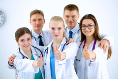 Portrait of doctors team showing thumbs up Royalty Free Stock Image