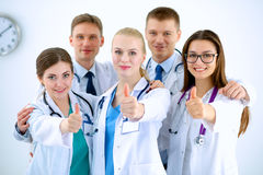 Portrait of doctors team showing thumbs up Royalty Free Stock Photo