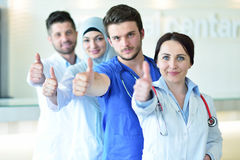 Portrait of doctors team showing thumbs up Stock Photos