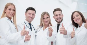 Portrait of doctors team showing thumbs up Stock Images